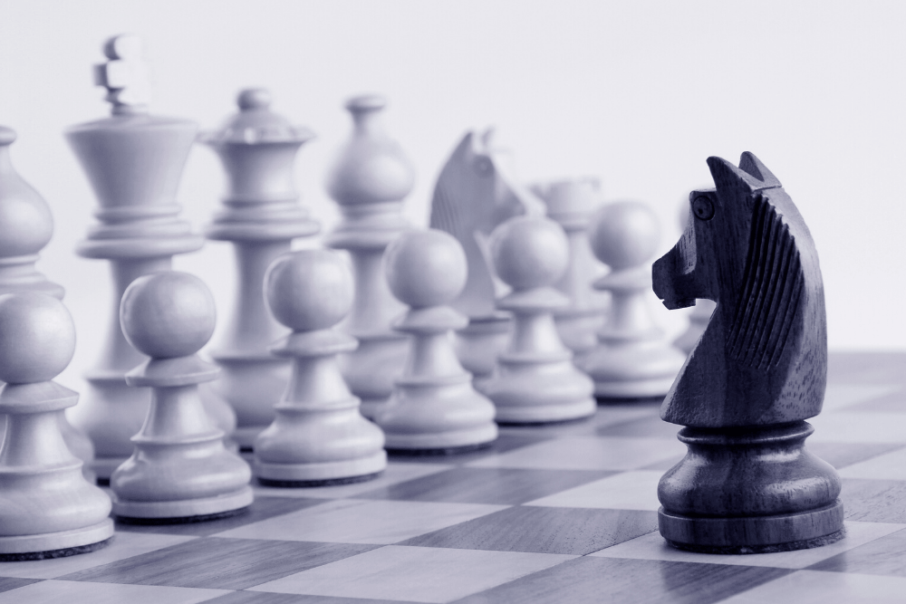 A chess board with pieces positioned on the board.